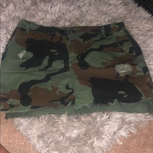 Distressed camo mini skirt